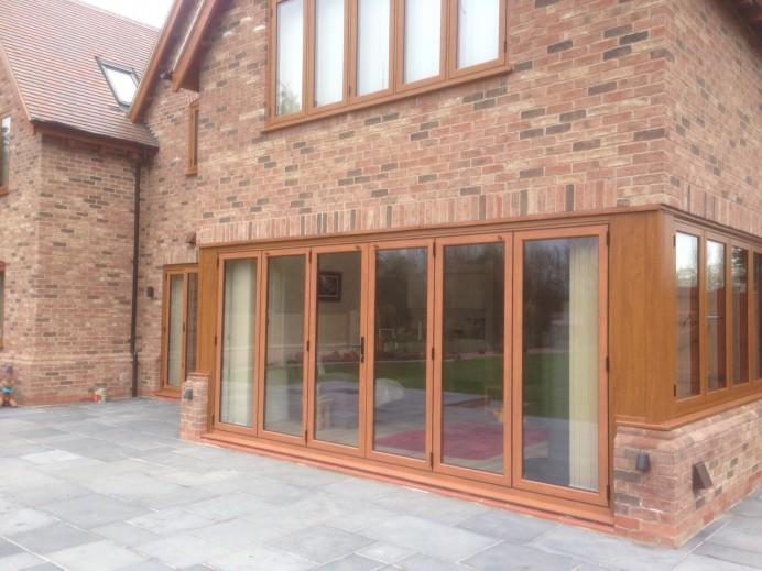 Light Oak Aluminium Sliding and Bi-Fold Doors in Derby