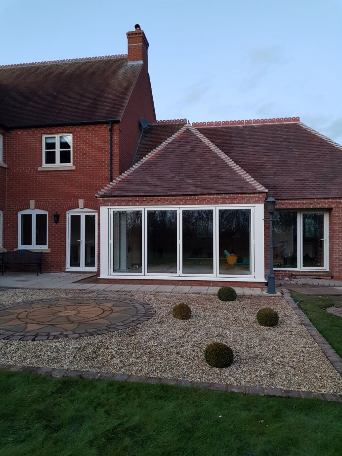 Doors and windows fitted in an extension