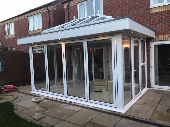 Orangery Installed With Four Pane Bi Fold, Two Single Doors and a French Door
