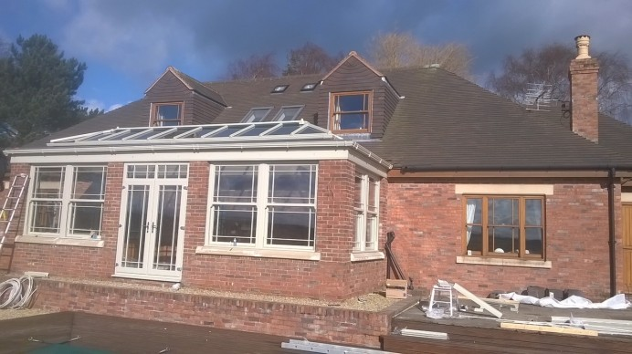 Orangery Fitting Complete with Sash Windows and Doors
