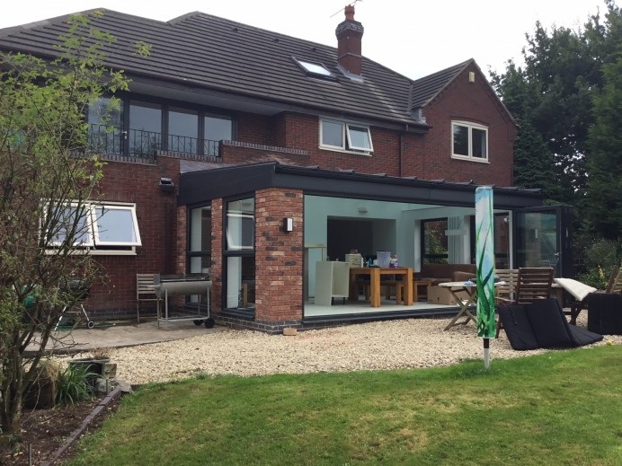 Walnut Conservatory Transformed into Bespoke Glass Building in Anthracite Grey