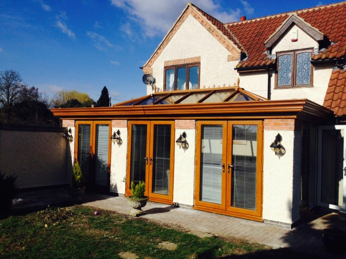 Golden Oak Orangery Fitted with Three Sets of Patio Doors