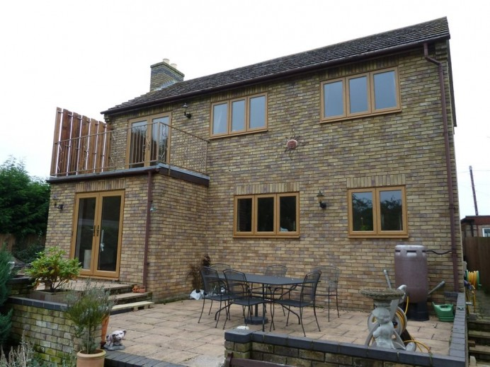 Entire Property Fitted with Light Oak Windows and Exterior Doors