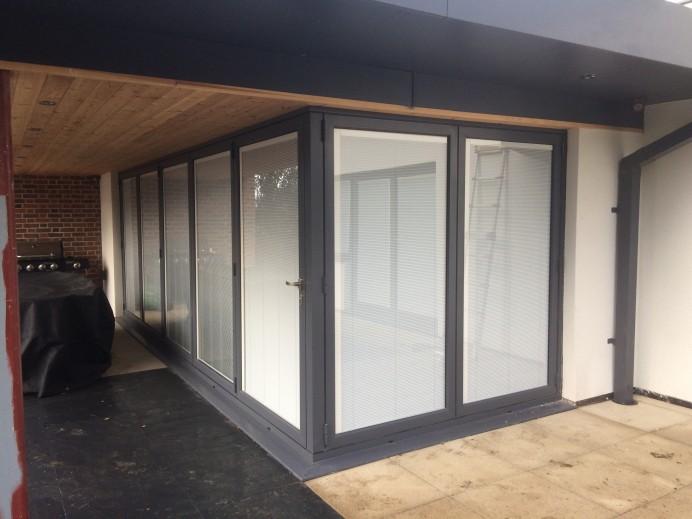 Corner Bi Fold Doors with Glass Integral Blinds