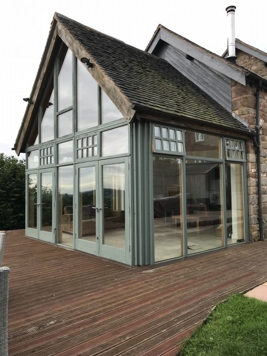 Gable Window and Bi Fold Doors Installed at Customers Property