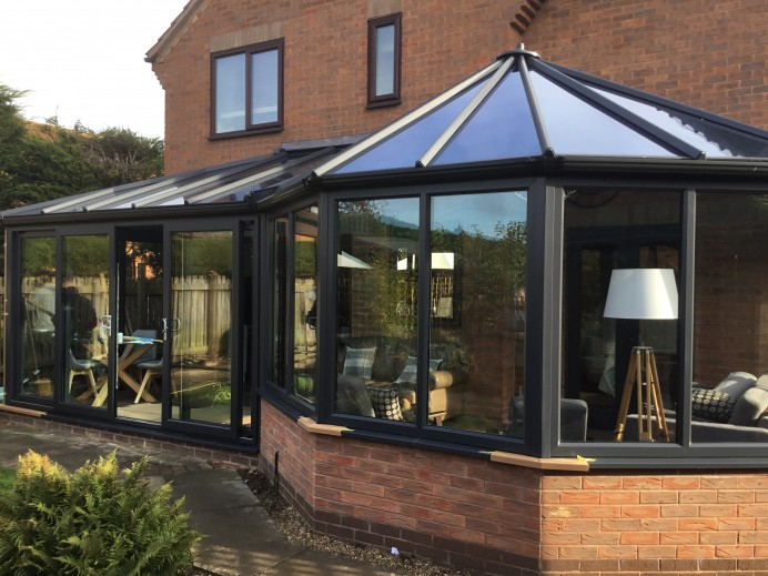 P Shape Conservatory Installed Across Rear of Customers House