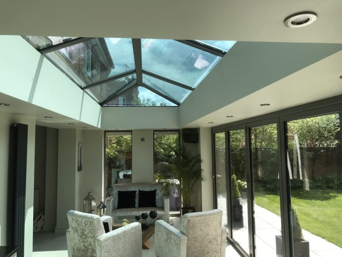 Dark Silver Metallic Orangery Built at the Back of Home