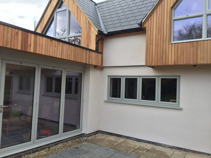 Pebble Grey Origin Windows, Bi Fold Doors and a Sunflex SVG30 Sliding Door