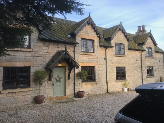 Classic Stone Work Building Fitted With Beautiful Classic Designed Windows and Bi Fold