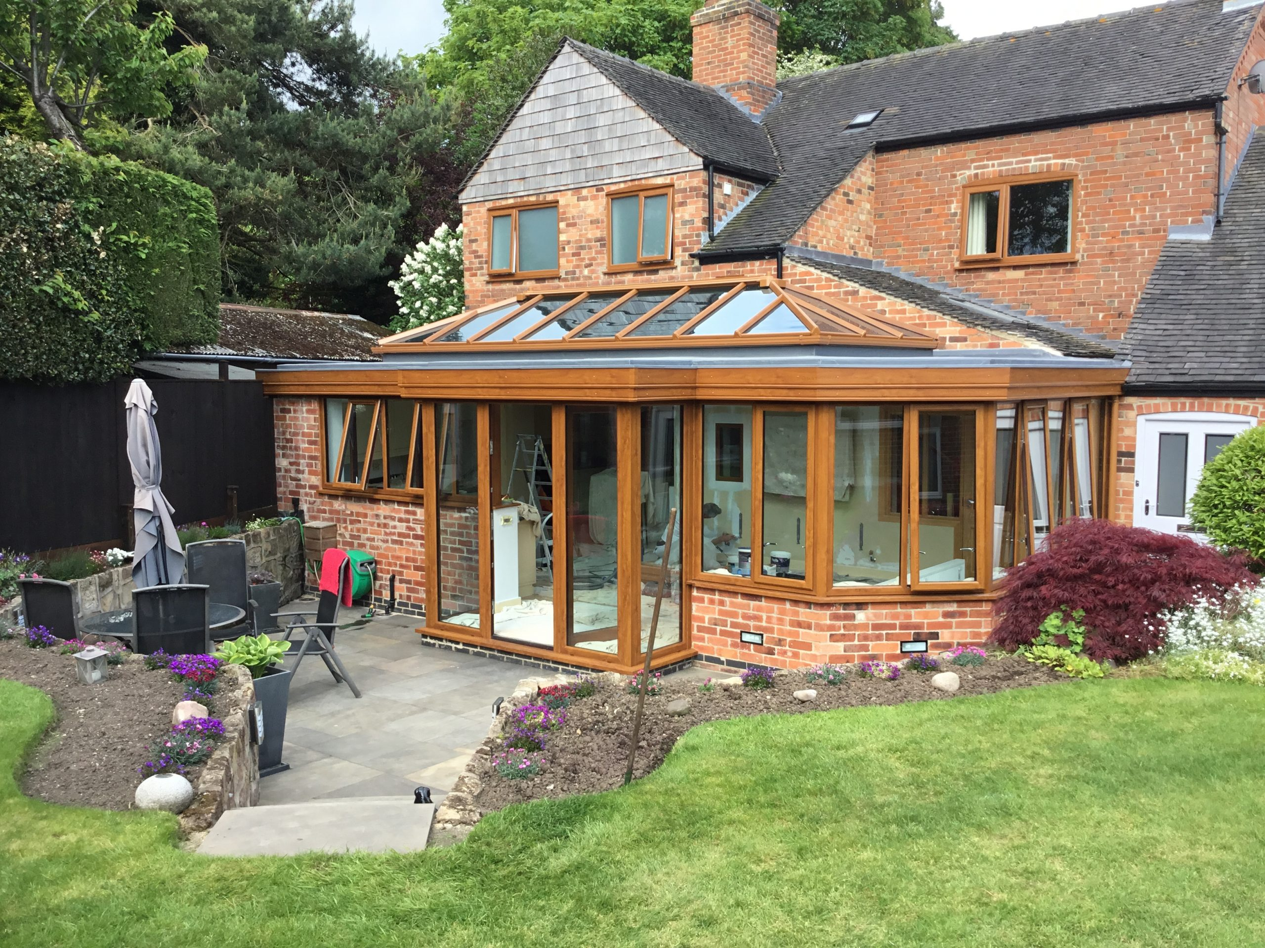Conservatory with Kitchen Updated with Orangery Roofing System